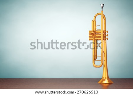 Old Style Photo. Polished Brass Trumpet on the table - stock photo