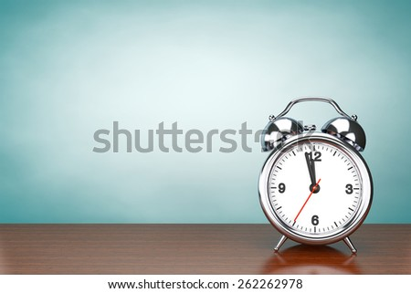Old Style Photo. Rare Chrome Alarm Clock on the table - stock photo