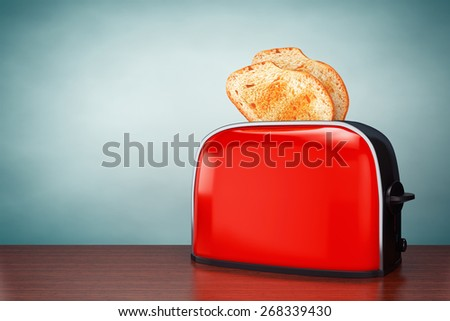 Old Style Photo. Toast popping out of Vintage Red Toaster on the table - stock photo