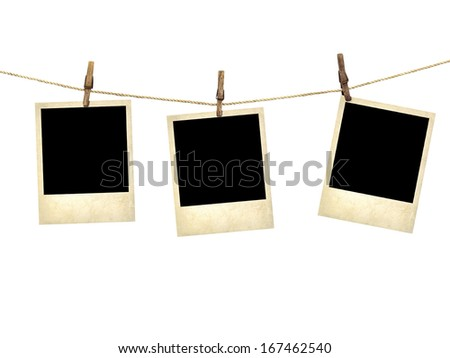 Old style photographs  hanging on a clothesline isolated on white background - stock photo