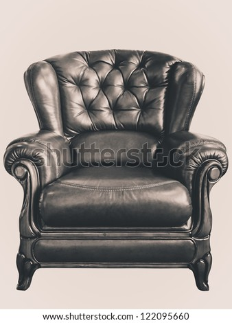 Old style retouch photograph of dark leather armchair on isolate background - stock photo