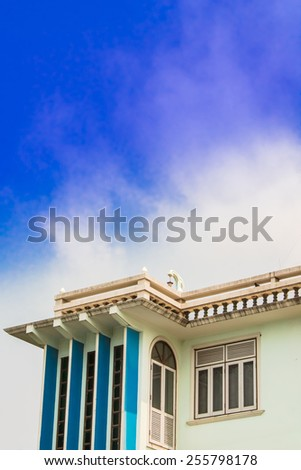 Old style roof and terrace on blue sky background. Old style roof and terrace. - stock photo