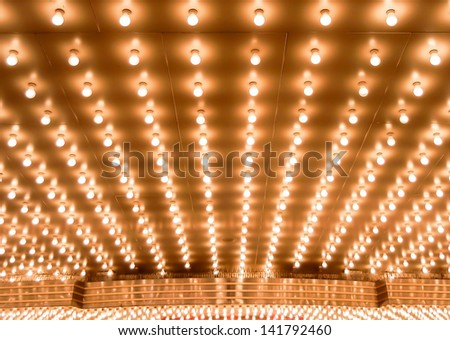 Old style theater marquee lights walkway to the theater. Aligned theater lights of Chicago Theater. Casino lights - stock photo