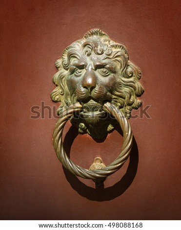 Old style venetian door knocker in the form of lion