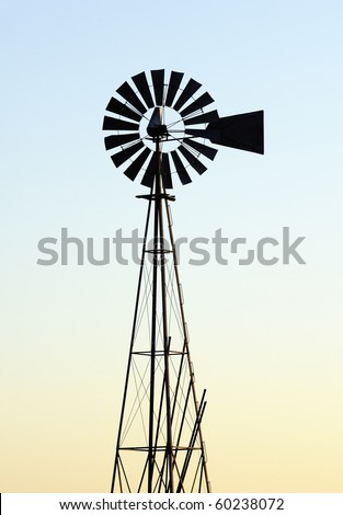 old style windmill silhouette at sundown