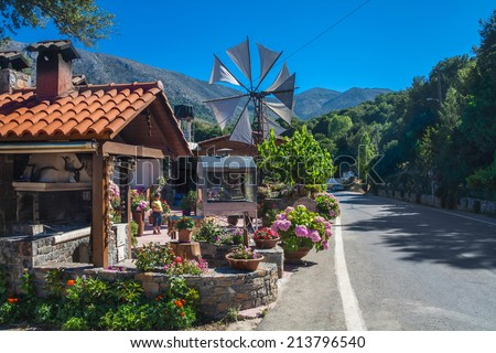 Old-style windmill used as typical touristic attraction. Crete, Greece - stock photo