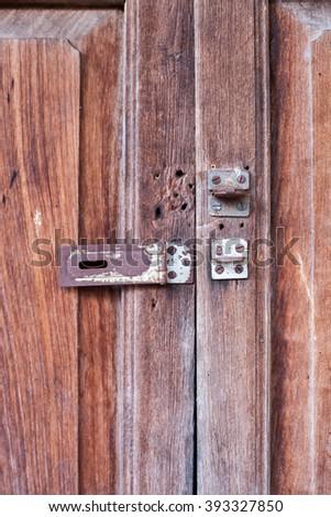 Old style wooden door locked - stock photo