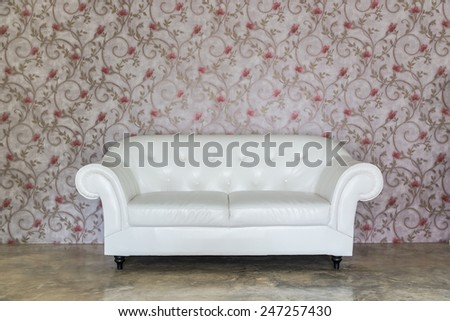 Old styled white leather sofa