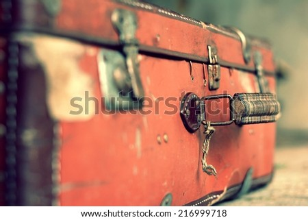 Old stylish brown suitcase - stock photo