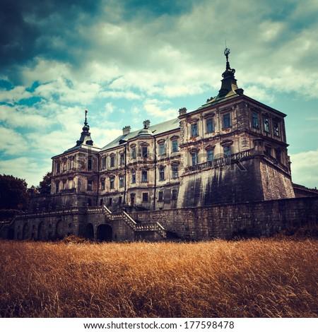 Old stylized Pidhirtsi Castle, village Podgortsy, Renaissance Palace, Lviv region, Ukraine - stock photo