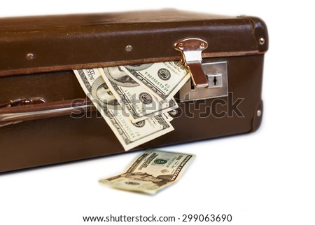 old suitcase full of money. shabby brown retro suitcase with world currencies - stock photo