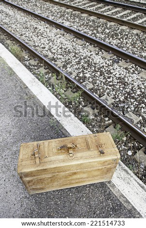 Old suitcase in a train station, detail of a vintage suitcase for travel