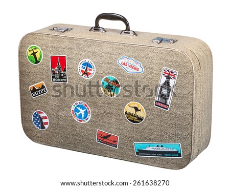 old suitcase traveler isolated on a white background - stock photo