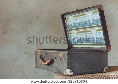 Old suitcase with the lid open