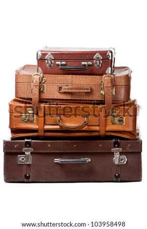 Old suitcases isolated on a white background - stock photo
