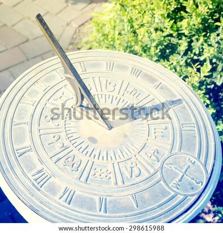 old sun clock dial in a garden - stock photo
