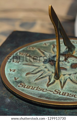 Old sun clock dial - Vintage sundial - stock photo