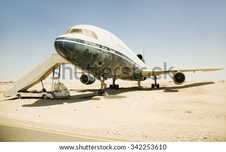 Old, superannuated aircraft in desert - stock photo