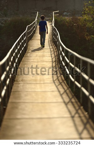 old suspension bridge, made of wood and iron. - stock photo