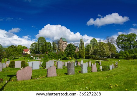 Old sweden church with cemetery in small town near Stockholm - Vallentuna, spring vivid natural outdoor Sweden background - stock photo