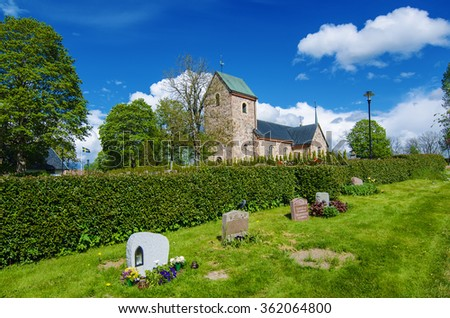Old sweden church with cemetery in small town near Stockholm - Vallentuna, vivid natural outdoor Sweden background - stock photo