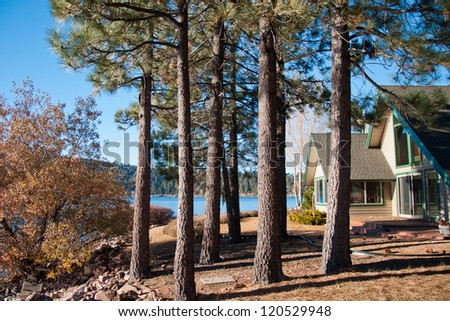 Old Swedish summer cottage at a lake - stock photo