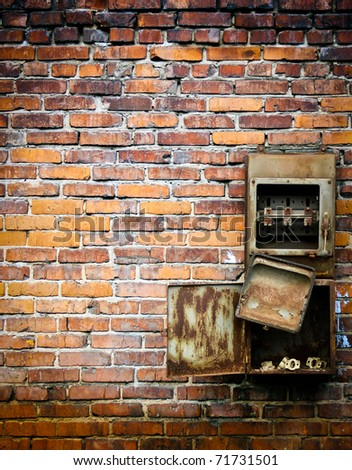 old switch on a brick wall - stock photo