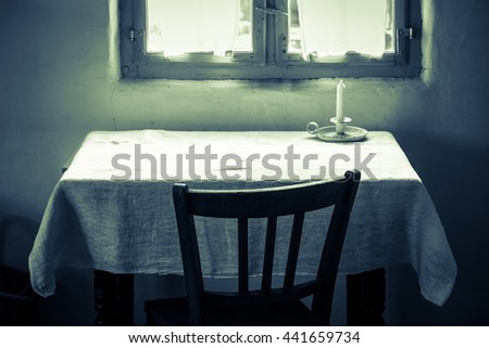 old table and chair at a log cabin - stock photo
