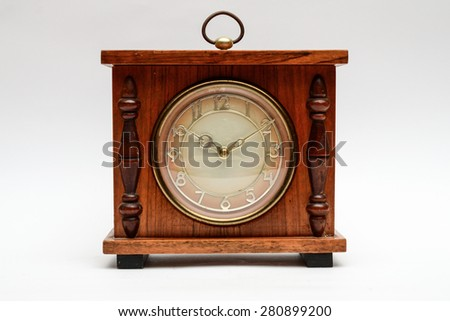 old table clock on a white background - stock photo
