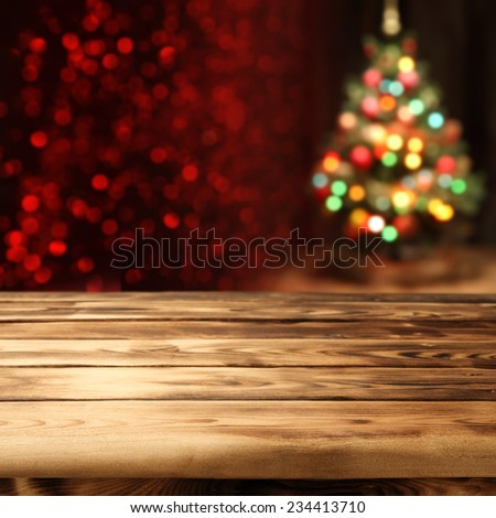 old table for products and xmas tree  - stock photo