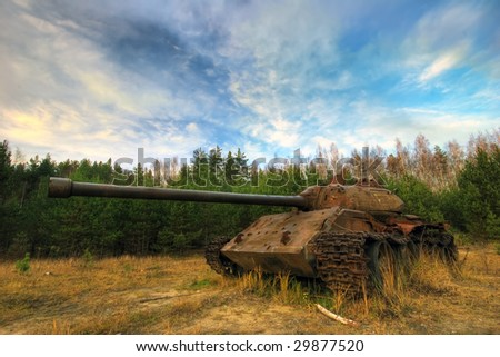 Old tank in the field - stock photo