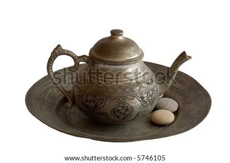 Old Tea Pot with Stones - stock photo