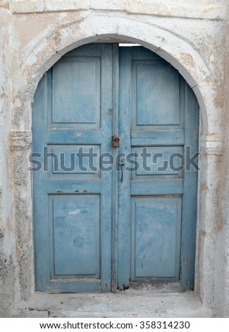 Old Teal Colored Door - stock photo