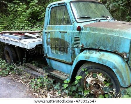 Old Teal Truck Next to the Hillside