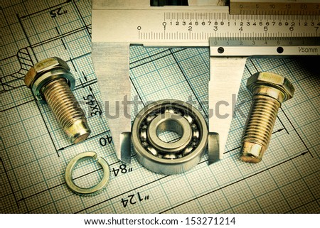 Old technical drawing and caliper with bearing - stock photo