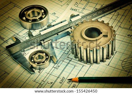 Old technical drawing and pinion with bearings - stock photo