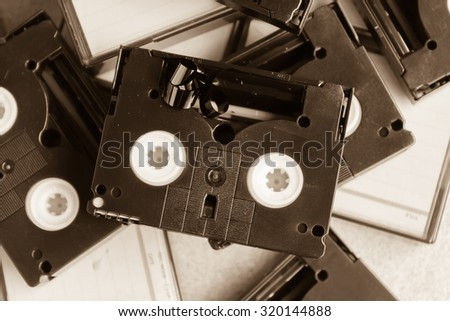 old technology mini DV tape recording made in vintage old time colour tone - stock photo