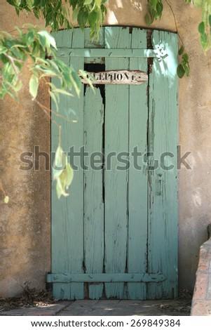 Old telephone box with peeling paint - stock photo