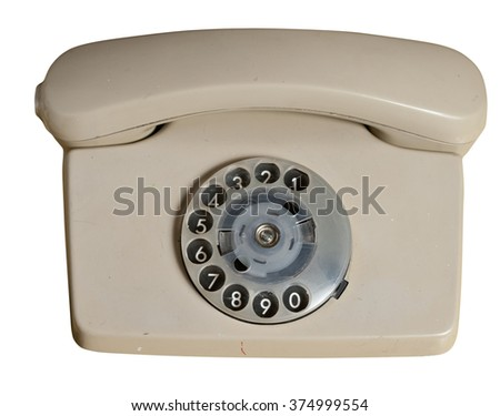 Old telephone isolated on white background, clipping path. - stock photo