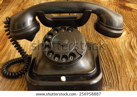 old telephone on wood / vintage style