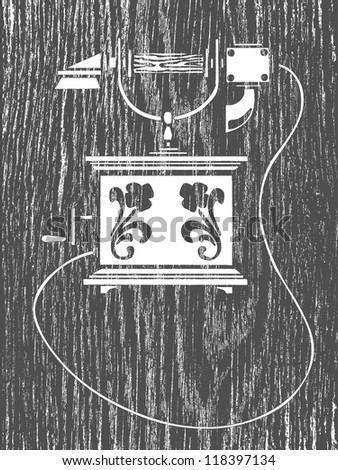 old telephone silhouette on grunge background