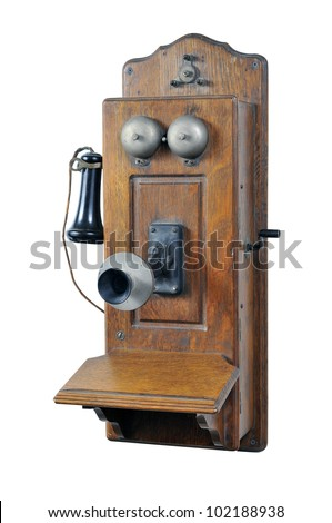 Old Telephone with hand crank isolated on white - stock photo