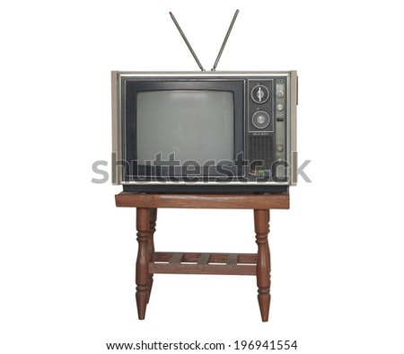 Old television on small table.