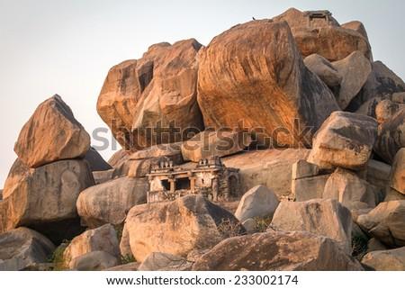 Old temple between stones in Hampi, Karnataka, India - stock photo