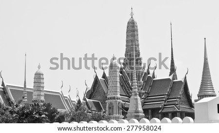 Old temple, Temple of the Emerald Buddha, Wat Phra Kaew monochrome in Bangkok, Thailand. In Thailand public domain or treasure of Buddhism. no copyright, no name of artist appear. - stock photo