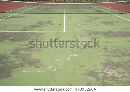 Old tennis hardcourt texture - stock photo