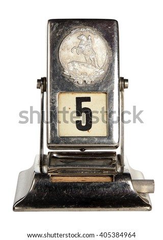 Old the retro an appointment desk metal calendar is isolated on a white background. Fifth  - stock photo
