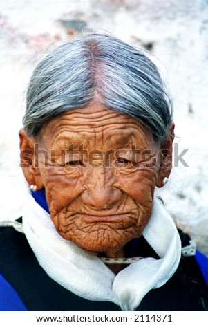 old Tibetian woman - stock photo