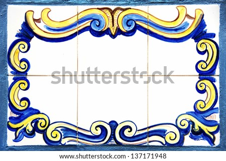 Old tile plaque in wall - stock photo