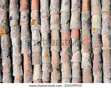 Old tile roof texture. Weathered surface of ancient roof of italian little house. Italy, Sicily. - stock photo